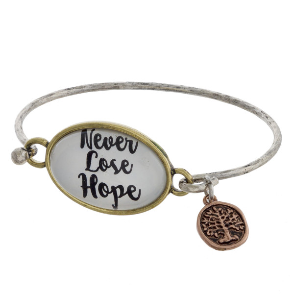 """Cuff bracelet with charm and message, """"Never Lose Hope."""" Approximate 2.5 in diameter."""