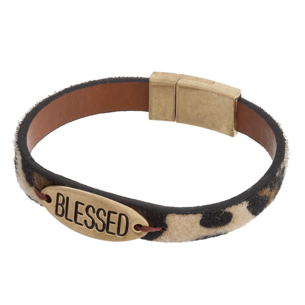 """Furry faux leather bracelet featuring """"Blessed"""" engraved focal and a magnetic clasp closure. Approximately 2.5"""" in diameter unstretched. Fits up to 5"""" wrist."""