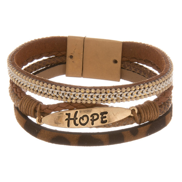 """Three layered faux leather bracelet featuring a metal """"Hope"""" engraved focal, animal print and a magnetic clasp closure. Approximately 2.75"""". Fits up to a 6"""" wrist."""