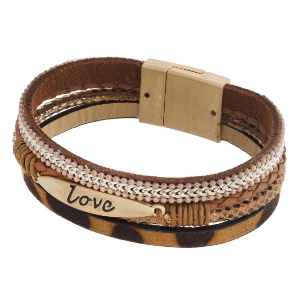 """Three layered faux leather bracelet featuring a metal """"Love"""" engraved focal, animal print and a magnetic clasp closure. Approximately 2.75"""". Fits up to a 6"""" wrist."""