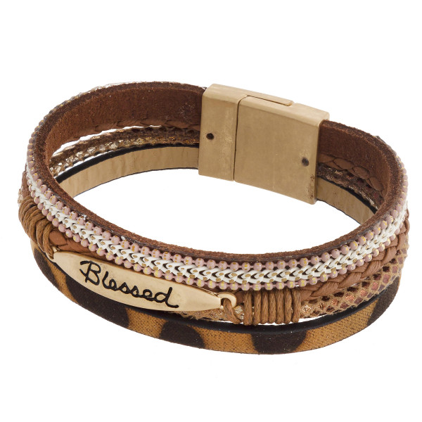 "Three layered faux leather bracelet featuring a metal ""Blessed"" engraved focal, animal print and a magnetic clasp closure. Approximately 2.75"". Fits up to a 6"" wrist."