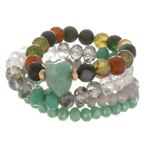 """Multi strand stretch bracelet with natural stone and bead details. Approximate 6"""" in length."""