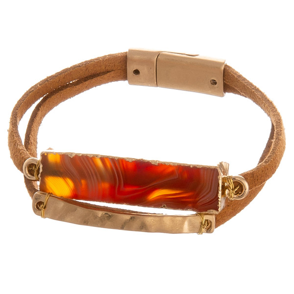 """Two layered faux leather bracelet featuring a natural stone inspired focal and magnetic closure. Approximately 2.75"""" in diameter. Fits up to a 5.5"""" in wrist."""