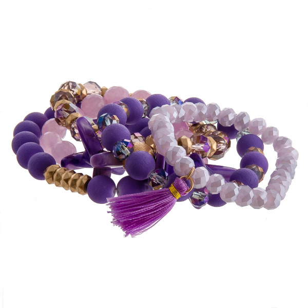 """Bracelet set featuring five stretch bracelets with resin beaded details and a tassel accent. Approximately 3"""" in diameter unstretched. Fits up to a 6"""" wrist."""