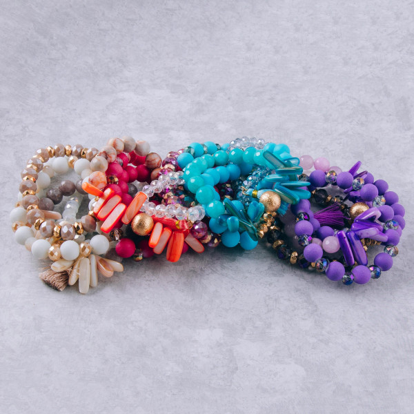 "Bracelet set featuring five stretch bracelets with resin beaded details and a tassel accent. Approximately 3"" in diameter unstretched. Fits up to a 6"" wrist."