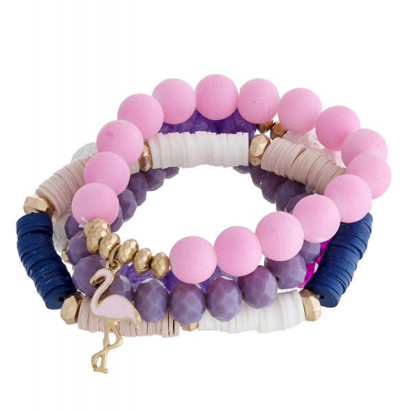 """Multi strand and color stretch bracelet with natural stone and beads and flamingo charm. Approximate 6"""" in length."""