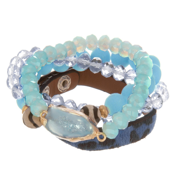 """Multi strand stretch bracelet with natural stone and bead details with faux leather band. Approximate 6"""" in length."""