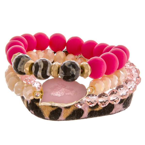 "Set of 4 bracelets featuring 3 beaded stretch bracelets and an adjustable animal print band. Approximately 2.5"" in diameter unstretched. Fits up to a 6"" wrist."