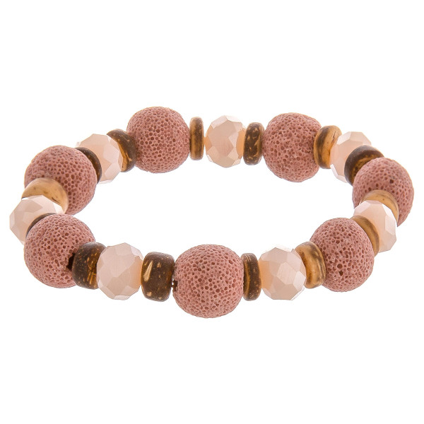 "Beaded stretch bracelet featuring natural stones, lava rock, and wood beads. Approximately 2.75"" in diameter unstretched. Fits up to 5"" wrist."