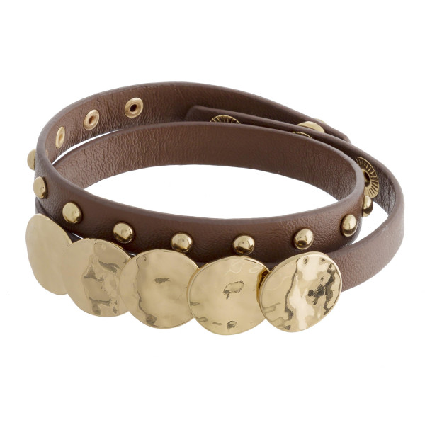 "Leather wrap around bracelet with gold wrist details. Approximate 15"" in length."