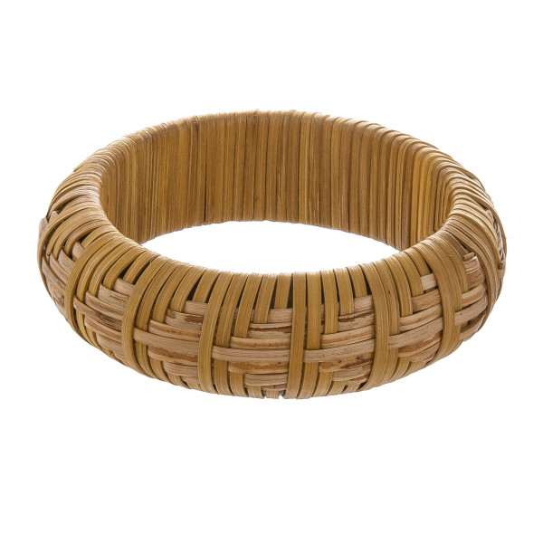 "Metal bracelet covered in wicker. Approximately 3"" in diameter."
