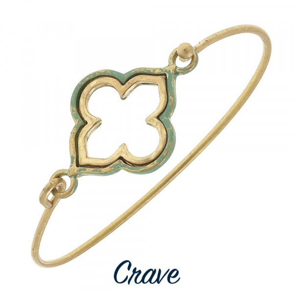 Dainty quatrefoil focal bangle bracelet with patina finish.