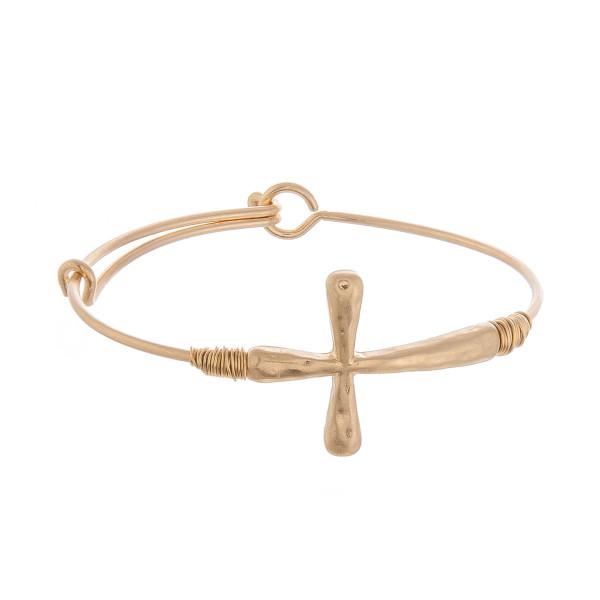 "Metal bracelet with cross wrist details. Approximate 2.5"" in diameter."
