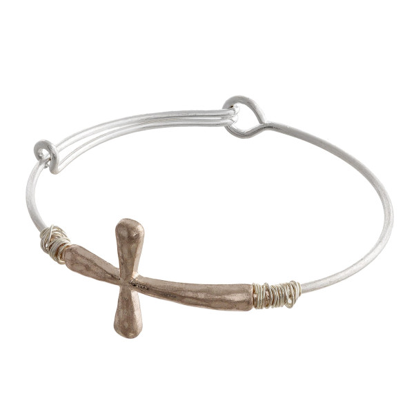 """Metal bracelet with cross wrist details and twisted metal. Approximate 2.5"""" in diameter."""