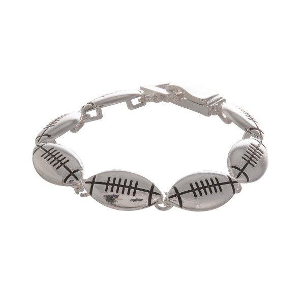 """Metal bracelet with football details. Approximate 7"""" in length."""