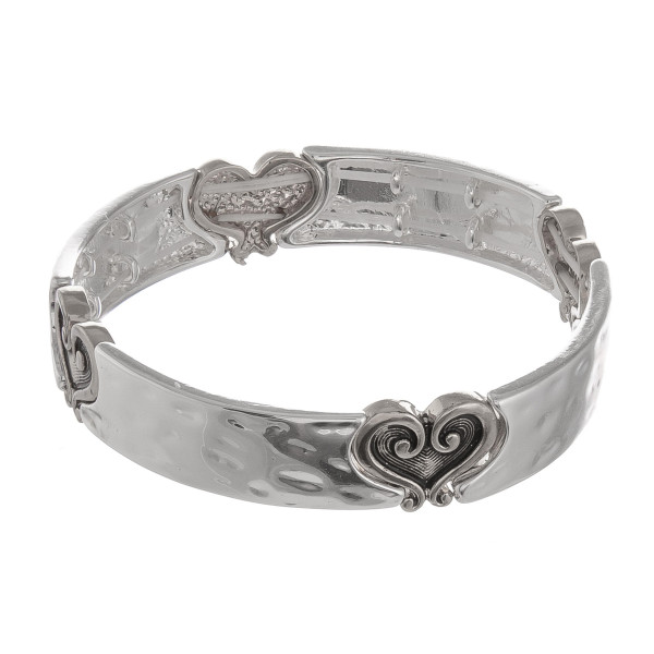 "Metal bracelet with engraved metal design details. Approximate 6"" in length."