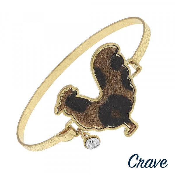 "Metal bracelet with hen details. Approximate 2.5"" in diameter."