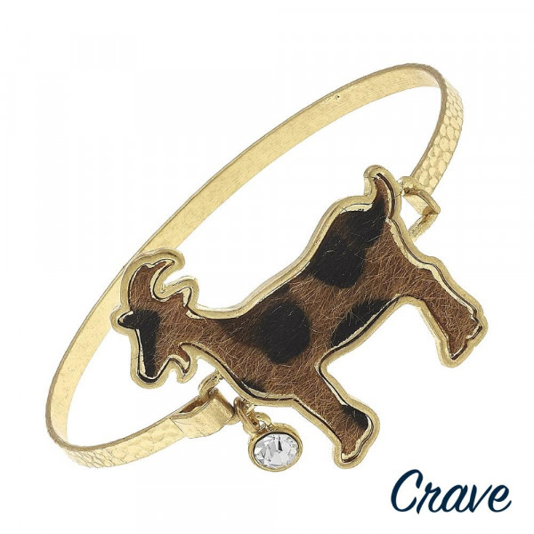 """Metal bracelet with goat details. Approximate 2.5"""" in diameter."""