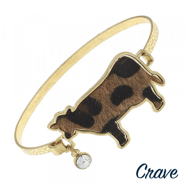 """Metal bracelet with cow details. Approximate 2.5"""" in diameter."""