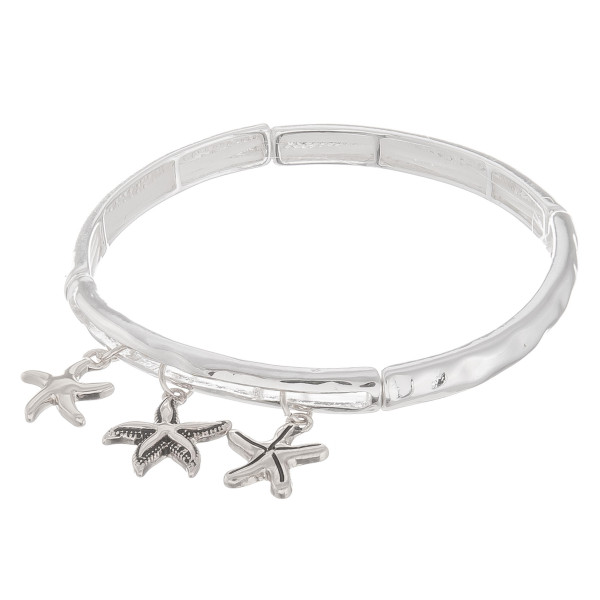 "Metal bracelet with starfish charms. Approximate 6"" in length."