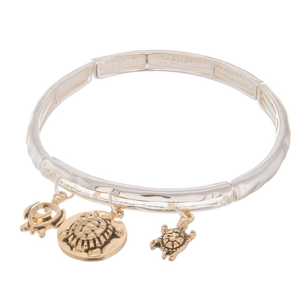 """Metal bracelet with turtle charms. Approximate 6"""" in length."""