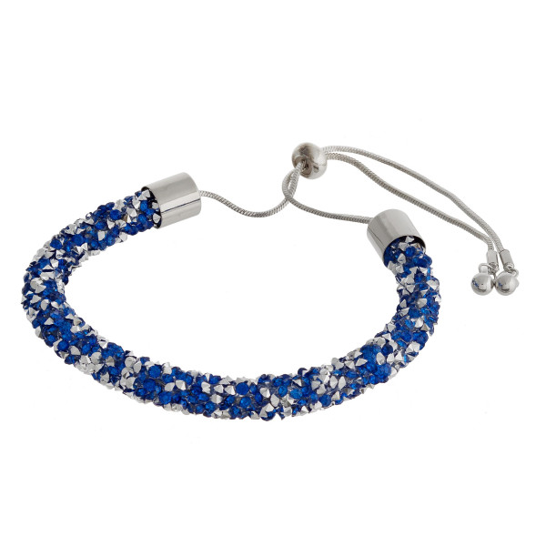 """Blue and silver rhinestone bracelet featuring a adjustable bolo closure. Approximately 3"""". Fits up to a 6"""" wrist."""