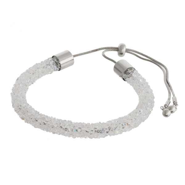 """White and silver rhinestone bracelet featuring a adjustable bolo closure. Approximately 3"""". Fits up to a 6"""" wrist."""