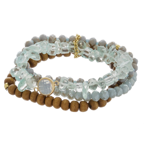 "Bracelet set featuring four stretch bracelets with natural stone, wood, faceted and iridescent beaded details. Approximately 3"" in diameter unstretched. Fits up to a 6"" wrist."