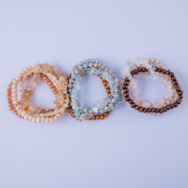 """Bracelet set featuring four stretch bracelets with natural stone, wood, faceted and iridescent beaded details. Approximately 3"""" in diameter unstretched. Fits up to a 6"""" wrist."""