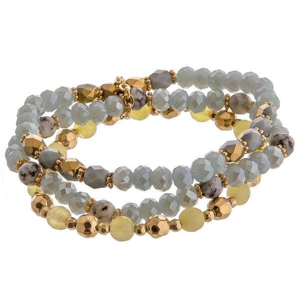 "Trio bracelet set featuring iridescent and natural stone beaded details with gold metal accents. Approximately 3"" in diameter unstretched. Fits up to a 6"" wrist."