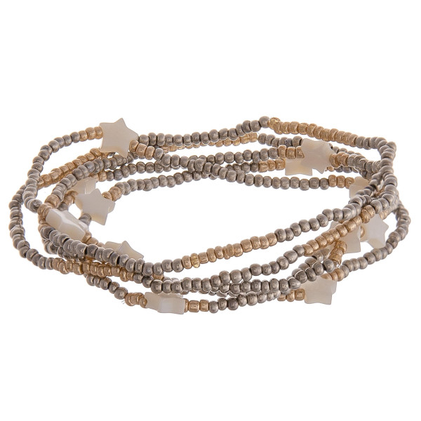 "Set of five stretch bracelet featuring silver and gold beads with star details. Approximately 2.5"" in diameter unstretched. Fits up to 5"" wrist."