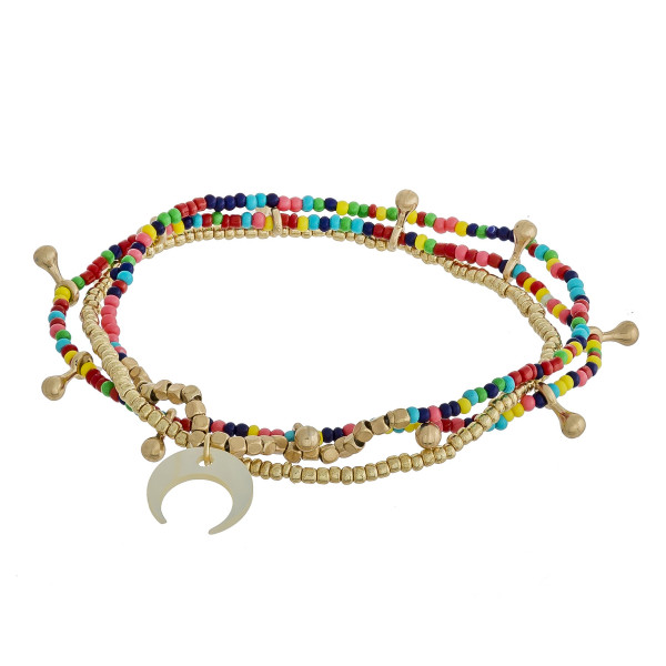 "Bracelet set featuring three beaded stretch bracelets with gold accents and a crescent detail. Approximately 2"" in diameter unstretched. Fits up to a 5"" wrist."