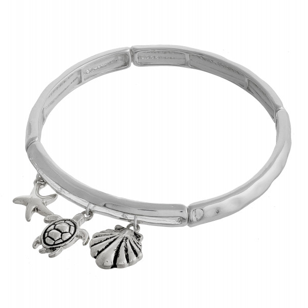 """Metal bracelet with sea charms details. Approximate 6"""" in length."""