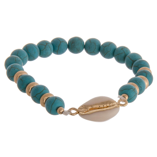 "Beaded stretch bracelet featuring turquoise natural stone inspired beads and a puka shell detail. Approximately 2.5"" in diameter unstretched. Fits up to a 5"" wrist."