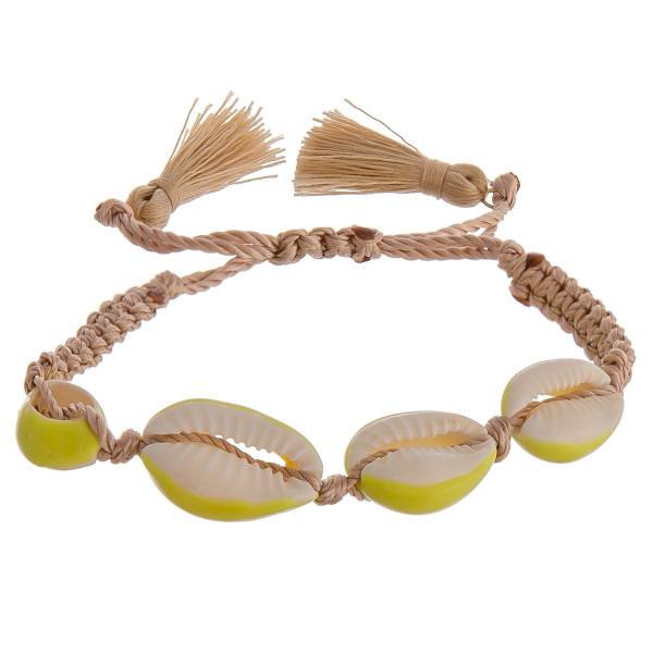 Wholesale fabric bolo bracelet Puka shell accents fan tassel detailing diameter