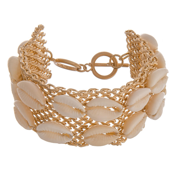 "Gold toggle clasp closure chain bracelet featuring puka shell accents. Approximately 8"" long when undone. Fits up to a 5.5"" wrist."