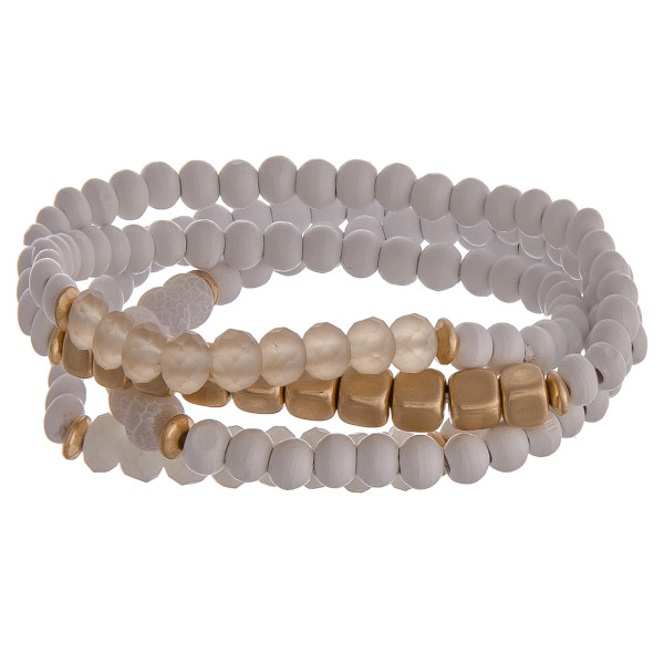 """Set of 4 natural stone inspired beaded bracelets featuring gold details and champagne accents. Approximately 2.5"""" in diameter unstretched. Fits up to a 6"""" wrist."""