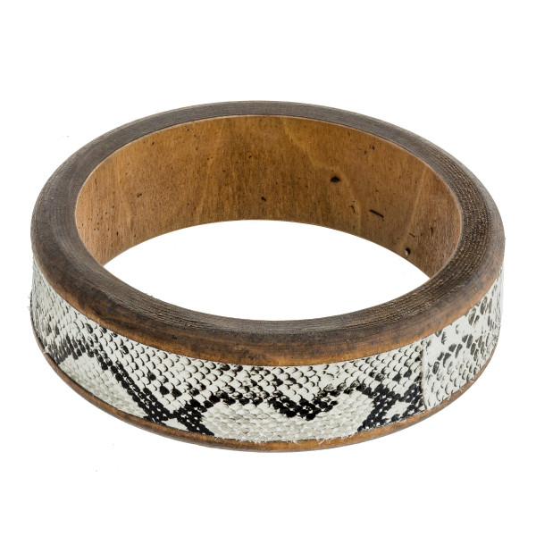 "Wood bracelet featuring snakeskin faux leather. Approximately 3"" in diameter. Fits up to 6"" wrist."