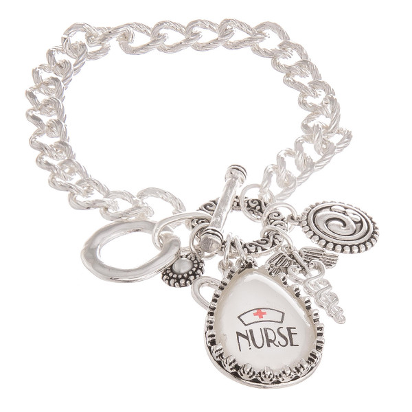 """Nurses are Kind, comforting, and compassionate, Don't forget to show appreciation our awesome nurses with a gorgeous metal bracelet with nurse charms for nurses week. Approximate 7"""" in length.  Don't forget to grab the matching necklace."""