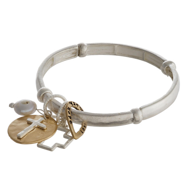 """Metal stretch bracelet featuring a """"Faith Love Hope"""" inspiring message with a teardrop, cross and pearl charm. Approximately 3"""" in diameter unstretched. Fits up to a 6"""" wrist."""