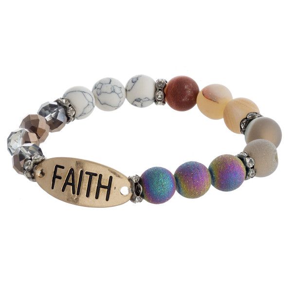 "Natural stone, iridescent beaded stretch bracelet featuring "" Faith"" engraved focal with rhinestone details. Approximately 3"" in diameter unstretched. Fits up to a 6"" wrist."