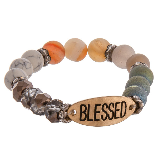 """Beaded stretch bracelet featuring """"Blessed"""" engraved focal with rhinestone accents. Approximate 2.75"""" in diameter unstretched. Fits up to 6"""" wrist."""