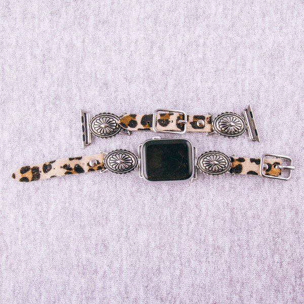 """Leopard print faux leather smart watch band featuring a flower inspired charm. Fits 38/40 mm size watch face. Approximately 6"""" in length. WATCH NOT INCLUDED."""