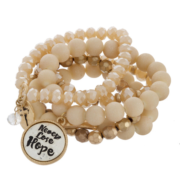"Multi strand natural stone beaded bracelet with never loose hope message. Approximate 6"" in length."