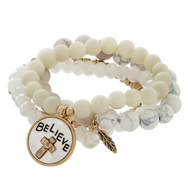 "Multi strand natural beaded bracelet with cross engraved charm ""Believe"". Approximate 6"" in length."