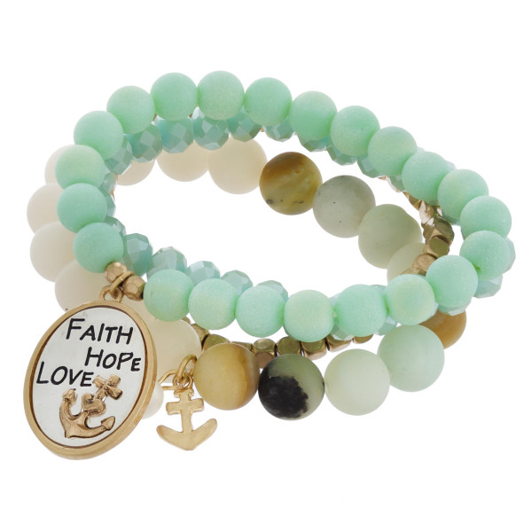 "Multi strand natural beaded bracelet with engraved charm ""Faith, hope, love"". Approximate 6"" in length."