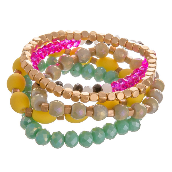 "Bracelet set featuring five multicolor beaded stretch bracelets with gold accents. Approximately 3"" in diameter unstretched. Fits up to a 6"" wrist."