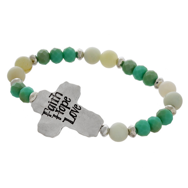 "Beaded stretch bracelet with engraved message, ""Faith, Hope, Love."" Approximate 6"" in length."