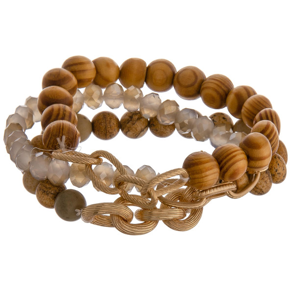 """Set of three beaded stretch bracelets featuring natural stone inspired beads, wood beads, and gold metal accents. Approximately 2.75"""" in diameter unstretched. Fits up to a 5"""" wrist."""