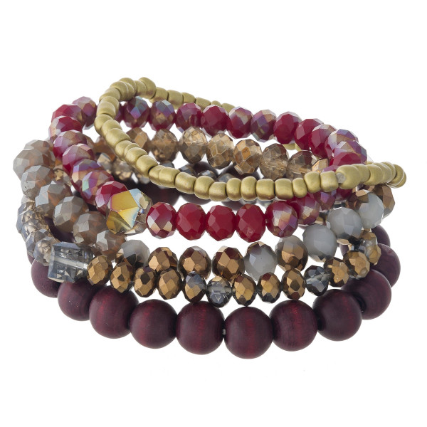 """Beaded stretch bracelet set featuring wood, faceted and gold plastic bead details. Approximately 3"""" in diameter unstetched. Fits up to a 6"""" wrist."""